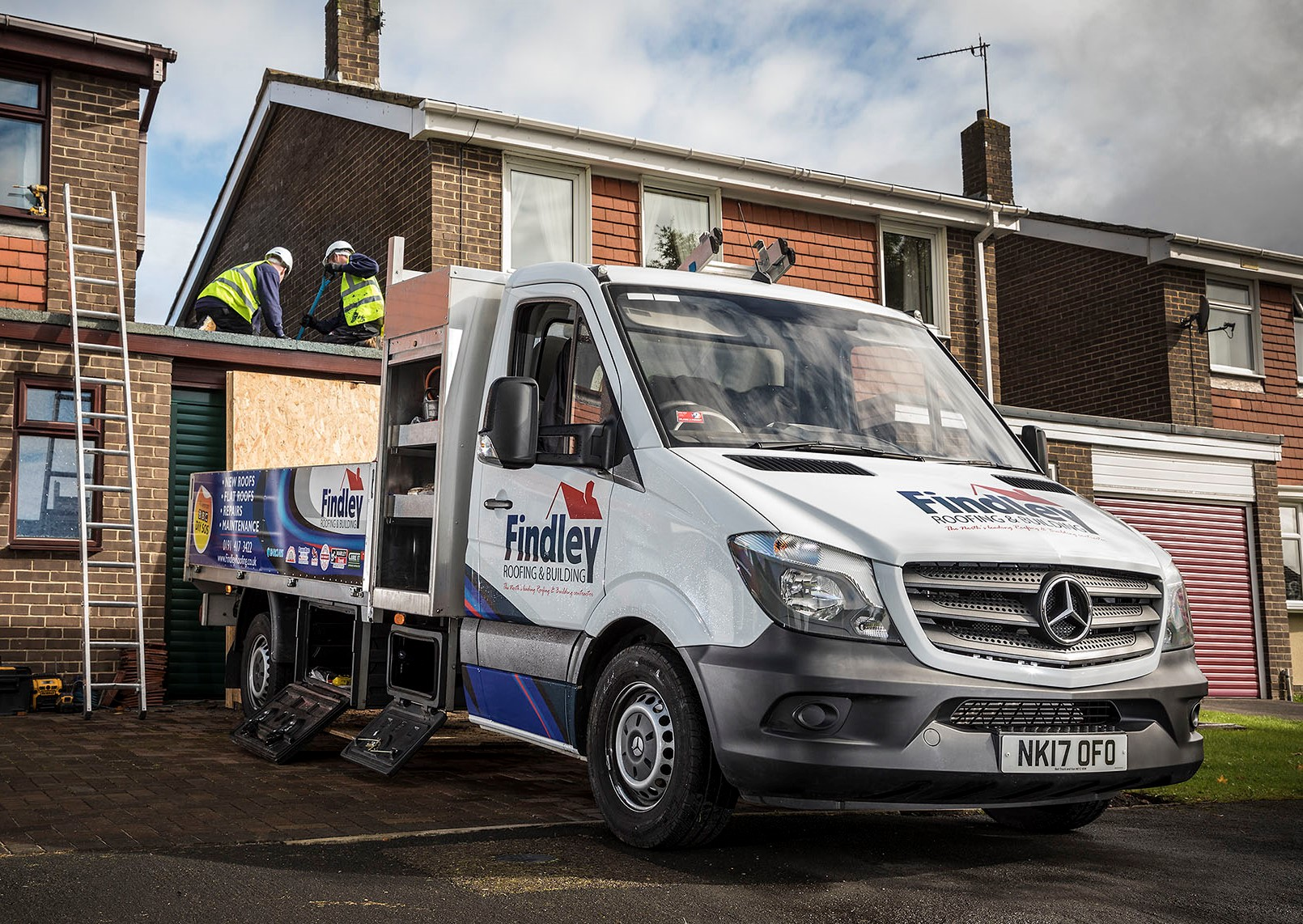 One of the new Findley Roofing vans